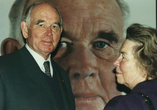 Collectors Peter and Irene Ludwig with Ludwig's portrait by Helnwein