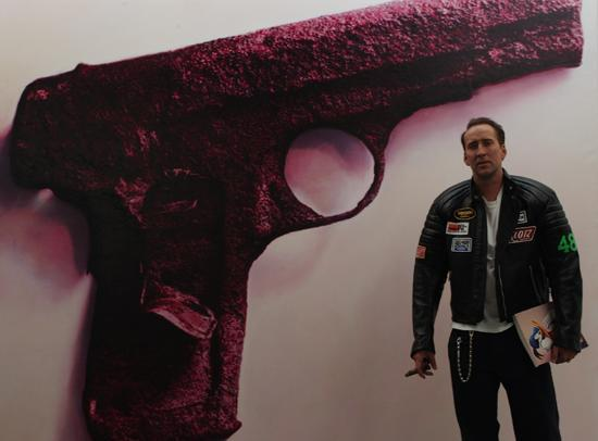 Nicolas Cage  and Red Gun