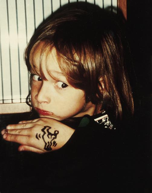 Ali Helnwein with Keith Haring drawing on his hand
