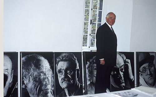 "Collector Peter Ludwig with ""Faces"" Photographs"